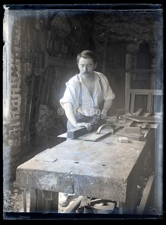 carpenter at work in his workshop France circa 1920s