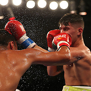 Jovan Perez (R) fights against Juan Aguirre during a Telemundo boxing match at the Kissimmee Civic Center on Friday, July 17, 2015 in Kissimmee, Florida.  Perez won the bout. (AP Photo/Alex Menendez)