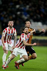 Stoke City's Joe Allen and Hull City's Jackson Irvine (right) battle for the ball