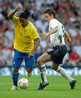 Photo: Richard Lane.<br />England v Brazil. International Friendly. 01/06/2007. <br />Brazil's Ronaldinho breaks past England's Frank Lampard.