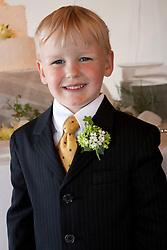 United States, Washington, Seattle, boy (age 5) wearing suit.