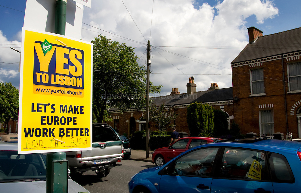"""Editorial Use Only: .""""Let's Make Europe Work Better - For the Rich"""".Defaced poster for the Yes campaign on Clonliffe Road, Dublin's north city, during Friday rush hour. ..The vote takes places on 12 June 2008. As of June 6th, the no-vote was reportedly overtaking the yes campaign.."""