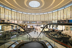 Interior of large atrium in Fashion Avenue section of Dubai Mall in United Arab Emirates