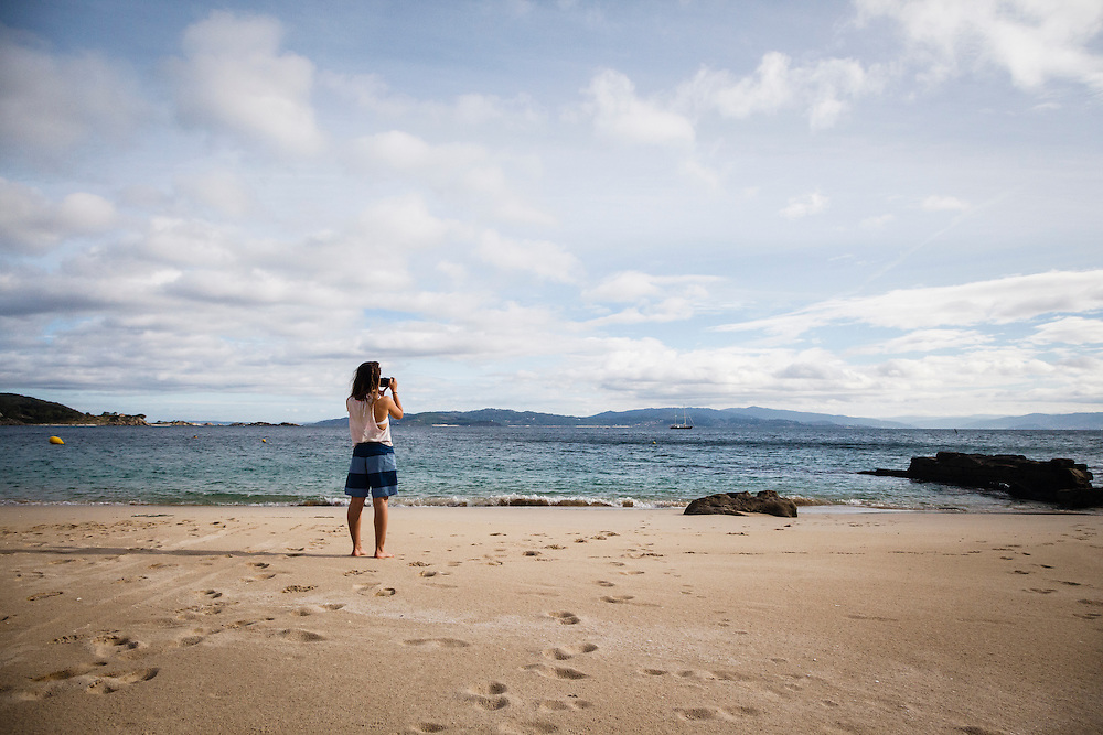 Josie White on the beach of the island San Martino, Cies Islands, Spain.