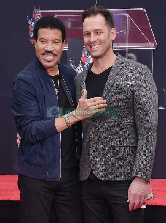 (L-R) Lionel Richie and Publicist Jeff Raymond at the Lionel Richie Hand and Footprint Ceremony held at the TCL Chinese Theatre in Hollywood, CA  on Wednesday, March 7, 2018. (Photo By Sthanlee B. Mirador/Sipa USA)
