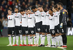 Derby County players stand for a minutes silence for Armistice day before kick-off