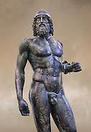 Torso face on view of the Riace bronze Greek statue A cast about 460 BC. statue A was probably sculpted by Myron. The style of the Riace statues straddles the archaic period and heralds the start of the classical period. Both statues depict strong young naked warriors who stand calmly but exuding great power. Museo Nazionale della Magna Grecia,  Reggio Calabria, Italy. .<br /> <br /> If you prefer to buy from our ALAMY STOCK LIBRARY page at https://www.alamy.com/portfolio/paul-williams-funkystock/greco-roman-sculptures.html . Type -    Riace     - into LOWER SEARCH WITHIN GALLERY box - Refine search by adding a background colour,  etc.<br /> <br /> Visit our ROMAN WORLD PHOTO COLLECTIONS for more photos to download or buy as wall art prints https://funkystock.photoshelter.com/gallery-collection/The-Romans-Art-Artefacts-Antiquities-Historic-Sites-Pictures-Images/C0000r2uLJJo9_s0