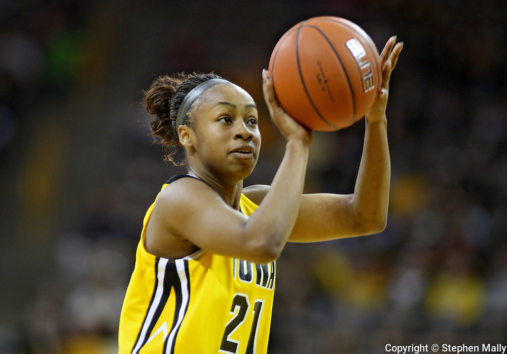 January 08 2010: Iowa guard Kachine Alexander (21) puts up a shot during the first half of an NCAA womens college basketball game at Carver-Hawkeye Arena in Iowa City, Iowa on January 08, 2010. Iowa defeated Ohio State 89-76.