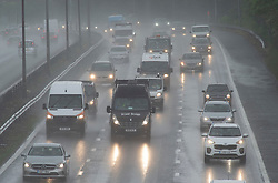 © Licensed to London News Pictures 18/05/2021.  Sevenoaks, UK. Motorists on the M25 near Sevenoaks in Kent are facing wet driving conditions this afternoon. The wet weather continues today in Kent with little sign of letting up. Photo credit:Grant Falvey/LNP