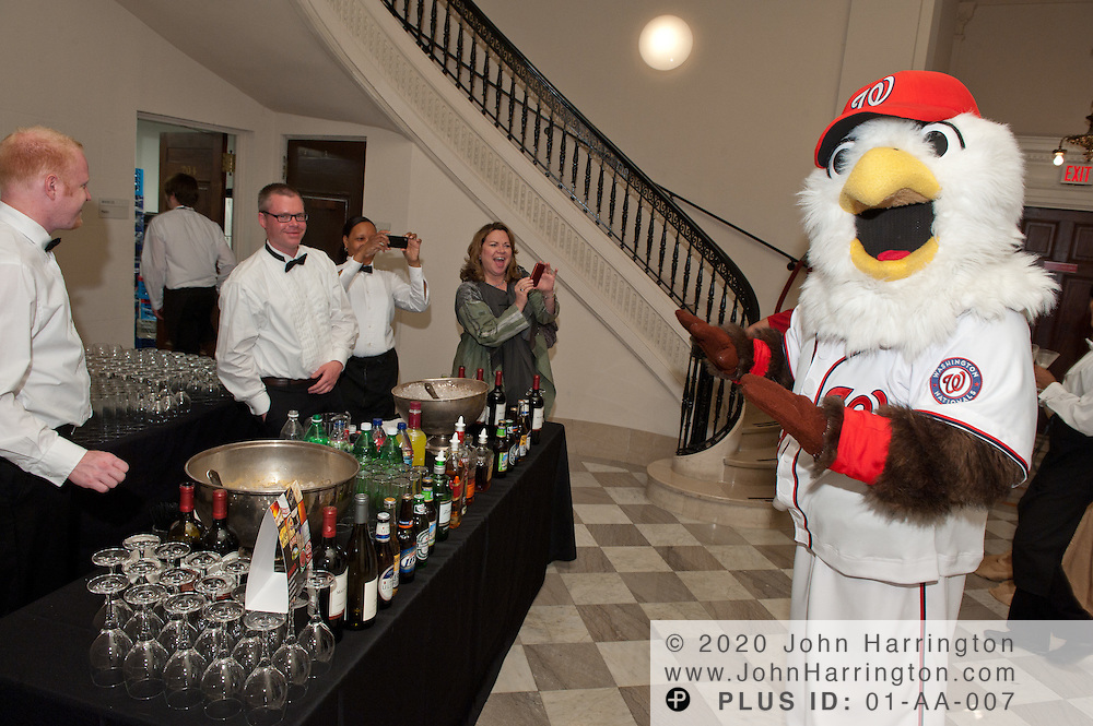 Washington National's mascot Screech poses for pictures at the Common Threads World Festival at the Carnegie Institution in Washington, DC on April 6th, 2011, brought together influential area chefs, politicians, and food enthusiasts for a fundraiser for after-school programs in Washington.