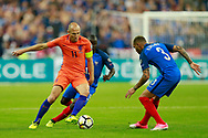 Netherlands' forward Arjen Robben challenges France's defender Layvin Kurzawa during the FIFA World Cup Russia 2018, Qualifying Group A football match between France and Netherlands on August 31, 2017 at the Stade de France in Saint-Denis, north of Paris, France - Photo Benjamin Cremel / ProSportsImages / DPPI
