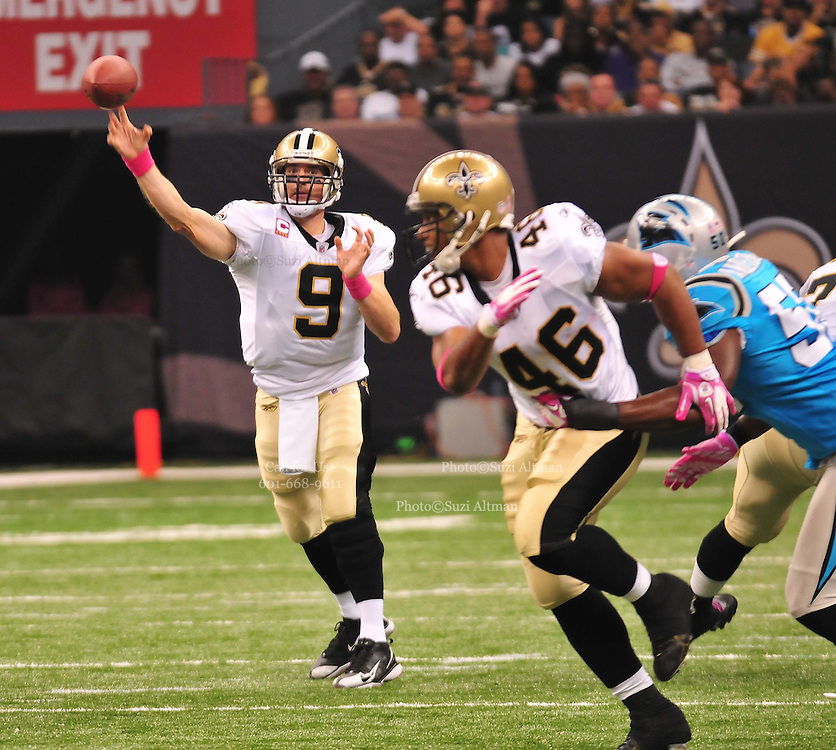 """New Orleans Saints QB throws a passto WR lance Moore for a touchdown during the game against the Carolina Panthers Sunday Oct. 3,2010.The NFL has gone """"Pink"""" for October in honor of Breast Cancer Awareness. The Saints went on to win 16-14. John Carney kicked three field goals to help the Saints win. PHOTO©SuziAltman.com"""