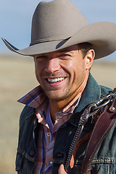 cowboy smiling outdoors