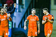 Luton Town midfielder George Moncur and Luton players celebrate at full time during the EFL Sky Bet League 1 match between Luton Town and Wycombe Wanderers at Kenilworth Road, Luton, England on 9 February 2019.