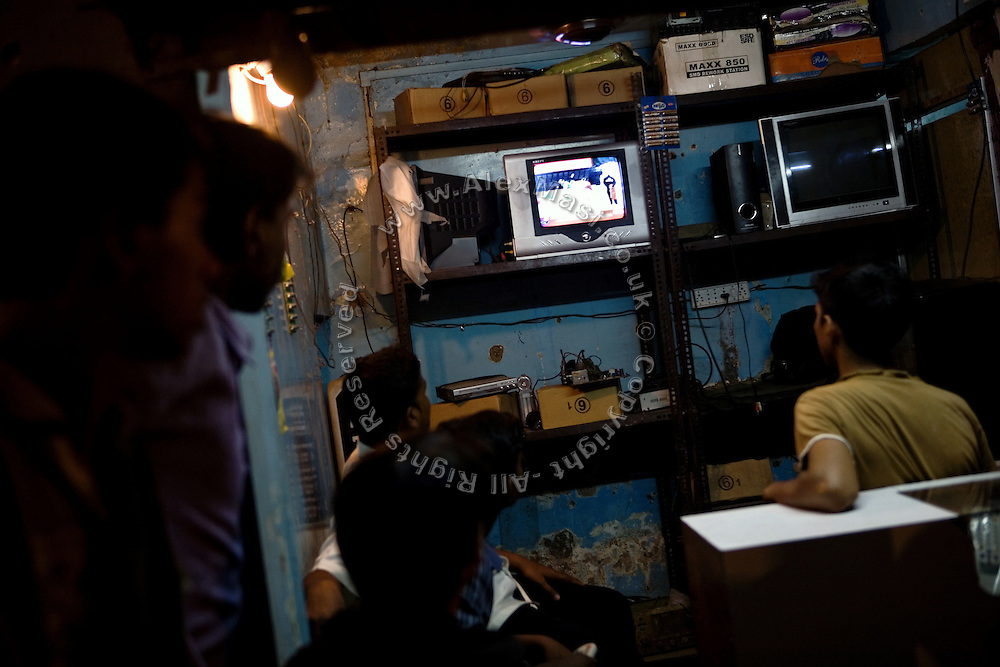 Indians are watching the national cricket finals 2009 in a shop on the streets of Shivaji Nagar, a Muslim neighbourood on the outskirts of Mumbai, India, on May 24th 2009. The match, played in the South African city of Johannesburg, was won by the Deccan Chargers against the Royal Challengers Bangalore. The 2009 cricket finals where played in South Africa because of national elections that were scheduled for the same period.