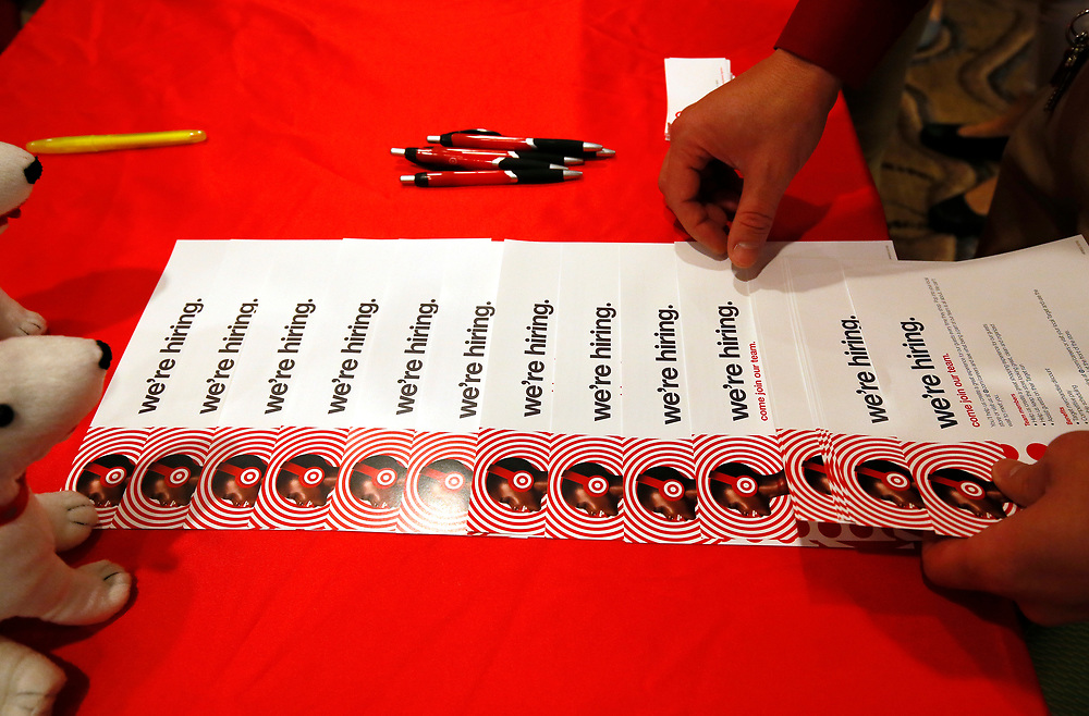 A sign seeking workers for Target is seen at a job fair in Golden, Colorado June 7, 2016. REUTERS/Rick Wilking