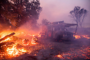 HEALDSBURG, CA - OCTOBER 27: Embers burn on a property devastated by the Kincade Fire in Healdsburg, California, U.S. on Sunday October 27, 2019. Photographer: Philip Pacheco/Bloomberg