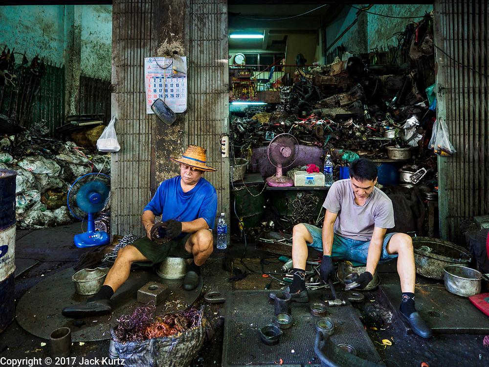 20 OCTOBER 2017 - BANGKOK, THAILAND: Men work in a mechanical shop in the Talat Noi neighborhood of Bangkok's Chinatown.       PHOTO BY JACK KURTZ