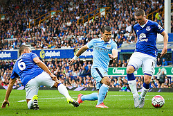 Sergio Aguero of Manchester City under pressure from Everton's Phil Jagielka and James McCarthy - Mandatory byline: Matt McNulty/JMP - 07966386802 - 23/08/2015 - FOOTBALL - Goodison Park -Everton,England - Everton v Manchester City - Barclays Premier League