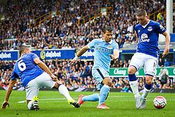 Sergio Aguero of Manchester City under pressure from Everton's Phil Jagielka and James McCarthy - Mandatory byline: Matt McNulty/JMP - 07966386802 - 23/08/2015 - FOOTBALL - Goodison Park -Everton,England - Everton v Manchester City - Barclays Premier League