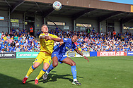 AFC Wimbledon attacker Michael Folivi (41) battles for possession with Bristol Rovers defender James Clarke (15) during the EFL Sky Bet League 1 match between AFC Wimbledon and Bristol Rovers at the Cherry Red Records Stadium, Kingston, England on 19 April 2019.