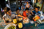 Breakfast-time at the riverside home of Solange and Francisco da Silva Correia near the town of Caviana, Amazonas, Brazil. (Solange Da Silva Correia is featured in the book What I Eat: Around the World in 80 Diets.)
