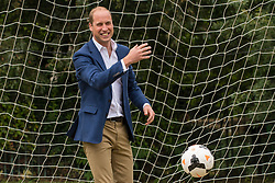 The Duke of Cambridge goes in goal as he joins in football practice with children from the Wildcats Girls' football programme, during a reception for the England Women football team at Kensington Palace in London.