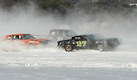 Pete Viano in #99, Caelan Taylor in #81 and Kyle MacDonald in #27 racing in the Stock class on Meredith Bay during Sunday's Nostalgic Latchkey Cup.  (Karen Bobotas/for the Laconia Daily Sun)