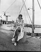 "Miss ""World Fishing"" 1971..1971..13.03.1971..03.13.1971..13th March 1971..To present the more glamorous side of the fishing industry B.I.M. (Bord Iascaigh Mhara) organised a Miss World style competition for young women within the fishing industry.The winner, selected from six finalists from fishing ports around the country, will represent B.I.M. at the forthcoming World Fishing Exhibition to be held in Ireland. The winner will receive an all expenses paid trip to Paris for two courtesy of Normandy Ferries and a complete ensemble from ""Open Till Eight"" fashions..Pictured is the winner of the ""Miss World Fishing"" competition, Ms Ann Scallan,Kilmore Quay,Co. Wexford. She is pictured wearing part of the ensemble supplied by ""Open Till Eight' fashions. In her official capacity, as ""Miss World Fishing"",she will present the glamorous side of Irish Fishing to the many foreign delegates expected at The World Fishing Exhibition."