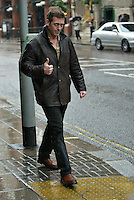 Hugh Laure 22/10/2002  stroling in the london rain