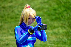 © Licensed to London News Pictures. 24/05/2019. LONDON, UK.  A cosplayer checks her make-up on the opening day of the bi-annual MCM Comic Con event at the Excel Centre in Docklands.  The event celebrates popular culture such as video, games, manga and anime providing many attendees with the opportunity to dress up as their favourite characters.  Photo credit: Stephen Chung/LNP