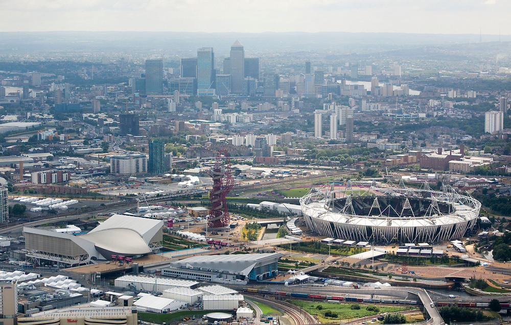 120705 Aerial shoot over Olympic Park, London. Image showing a view looking towards Canary Wharf of the Olympic Stadium, Aquatics Centre, Waterpolo Arena and the Orbit.<br /> Picture taken by Anthony Charlton