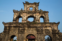 Duc Duc tomb is simpler and less grandiose than other tombs in Hue, yet it is evocative for its bucolic & undeveloped setting - free of souvenir vendors and even ticket entrance fees.  The entrance is a triple gate made of brick.  Behind, there is a courtyard decorated with parapets. In the middle of the surrounding wall is Huynh Oc house with its yellow tile roof.
