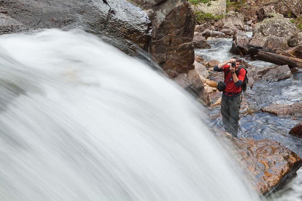 Obadiah Reid photographs a waterfall of the Big Thompson River in Rocky Mountain National Park, Colorado.