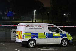 © Licensed to London News Pictures. 19/09/2021. London, UK. A forensic tent in the background and a police forensic services van parked at an entrance to Cator Park on Kidbrooke Park Road in Greenwich following a call at 17:32BST on Saturday 18/09/2021 to a body of a female found near the community centre. A man was arrested several hours later at approximately 21:20BST at an address in Lewisham on suspicion of murder and was taken into custody at a south London police station. Photo credit: Peter Manning/LNP