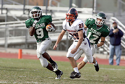 10 November 2007:  Marcus Dunlop makes a cut to escape Tyler Langs. This game between the Wheaton College Thunder and the Illinois Wesleyan University Titans was for a share of the CCIW Championship and was played at Wilder Field on the campus of Illinois Wesleyan University in Bloomington Illinois.