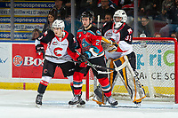 KELOWNA, BC - NOVEMBER 1: Kobe Mohr #25 of the Kelowna Rockets stick checks Marco Creta #3 in front of the net of Jacob Herman #33 of the Prince George Cougars  at Prospera Place on November 1, 2019 in Kelowna, Canada. (Photo by Marissa Baecker/Shoot the Breeze)