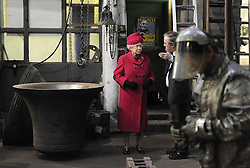 File photo dated 25/03/09 of Queen Elizabeth II speaking to owner Alan Hughes during a visit to the Whitechapel Bell Foundry in east London. The foundry, Britain's oldest manufacturing firm, is set to close at its current site, bringing an end to a family business that has run for almost 500 years.