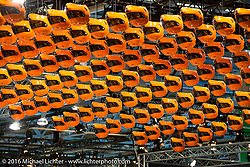 An impressive display with more than 200 Schuberth Helmets hanging from above at the Intermot Motorcycle Trade Fair. Cologne, Germany. Friday October 7, 2016. Photography ©2016 Michael Lichter.