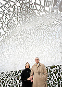 """John and Mary Pappajohn, inside """"Nomade"""" by Jaume Plensa.  Photographed in the John and Mary Pappajohn Sculpture Park,  Des Moines IA, for Apollo Magazine.  2009-10"""