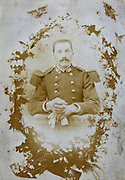 deteriorating portrait adult man posing in military uniform France 1880s