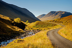 The river Etive and a single track road wind their way throught the Glen Etive -   Highlands of Scotland<br /> <br /> (c) Andrew Wilson   Edinburgh Elite media