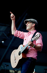 28 April 2013. New Orleans, Louisiana,  USA. .Joey Burns of Calexico playing the Gentilly stage at the New Orleans Jazz and Heritage Festival. .Photo; Charlie Varley.