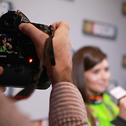 A photographer videotapes driver Danica Patrick as she speaks with the media during the NASCAR Media Day event at Daytona International Speedway on Thursday, February 14, 2013 in Daytona Beach, Florida.  (AP Photo/Alex Menendez)