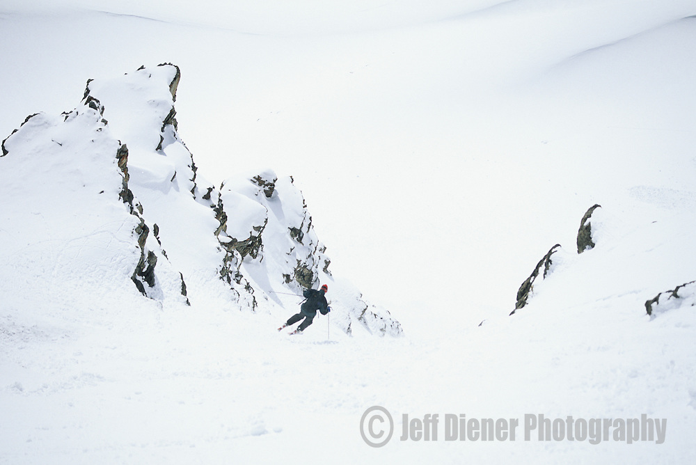 """A skier makes turns down """"Twice is Nice"""" in the Jackson Hole backcountry, Jackson Hole, Wyoming."""