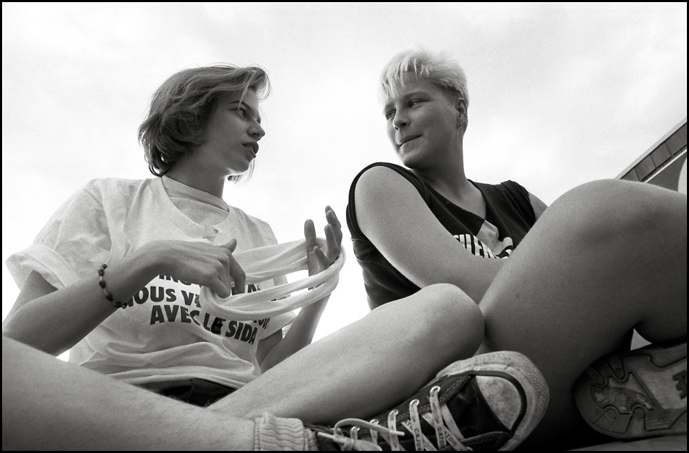 Heidi Dorow and Catherine Gund from ACT UP NY en route to Montreal where they stormed the Fifth International AIDS Conference in Montreal, at the time a members-only event for doctors and HIV/AIDS researchers. They took over seats reserved for dignitaries, and released their first Treatment and Data report calling for speedier access to AIDS drugs. June 4, 1989