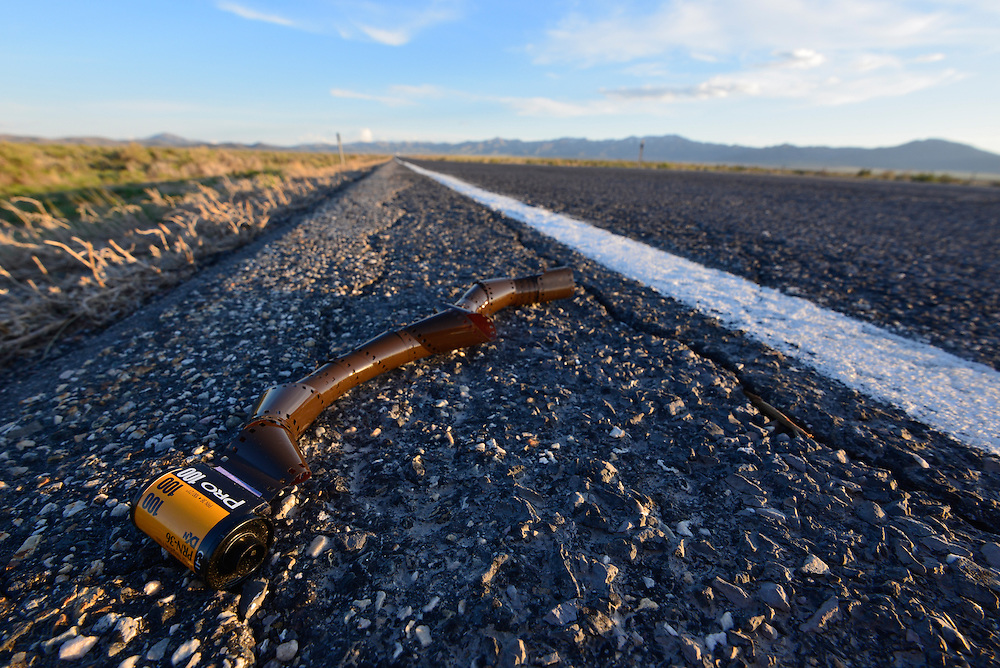 Discarded roll of film along the side of highway in the Great Basin region of Utah.