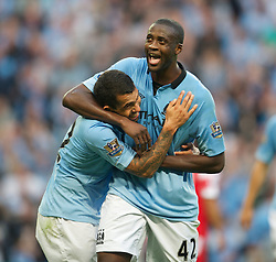 01.09.2012, Etihad Stadion, Manchester, ENG, Premier League, Manchester City vs Queens Park Rangers, 2. Runde, im Bild Manchester City's Carlos Tevez celebrates scoring the third goal against Queens Park Rangers with Yaya Toure during the English Premier League 2nd round match between Manchester City and Queens Park Rangers at the Etihad Stadium, Manchester, Great Britain on 2012/09/01. EXPA Pictures © 2012, PhotoCredit: EXPA/ Propagandaphoto/ David Rawcliff..***** ATTENTION - OUT OF ENG, GBR, UK *****