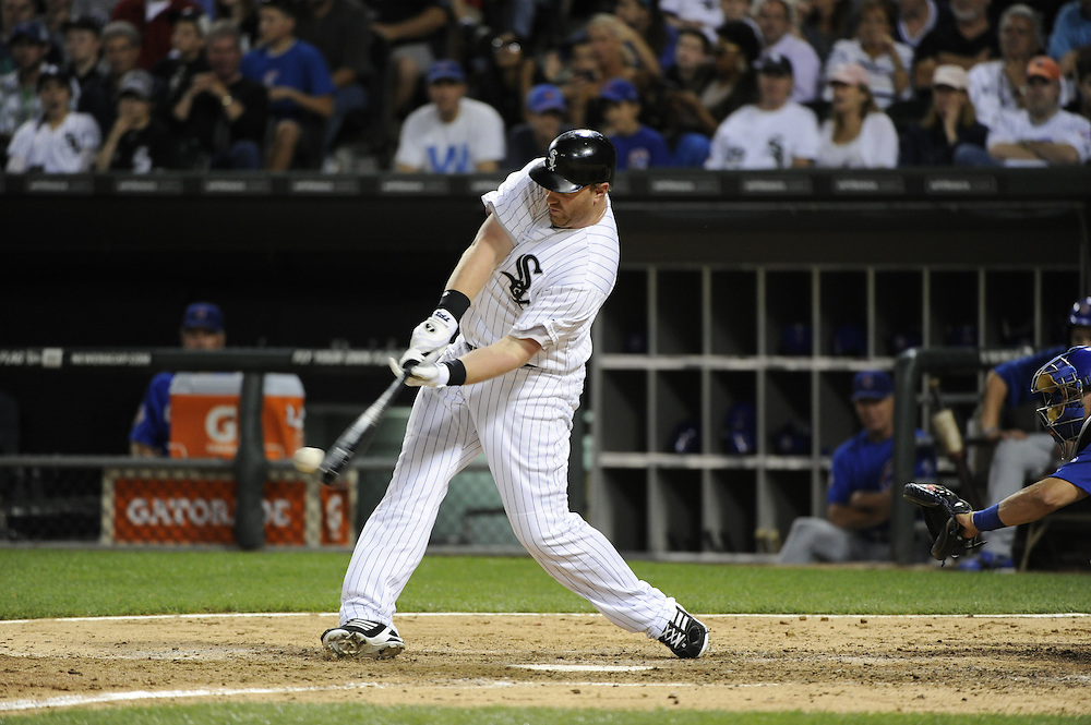 CHICAGO - JUNE 20:  Adam Dunn #32 of the Chicago White Sox bats against the Chicago Cubs on June 20, 2011 at U.S. Cellular Field in Chicago, Illinois.  The Cubs defeated the White Sox 6-3.  (Photo by Ron Vesely)  Subject:  Adam Dunn
