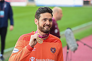 Craig Gordon (#1) of Heart of Midlothian FC is all smiles as he shows off his winners medal after the final whistle of the SPFL Championship match between Heart of Midlothian and Inverness CT at Tynecastle Park, Edinburgh Scotland on 24 April 2021.